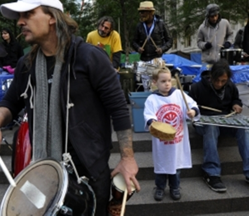 child play on zuccotti park_occupy wall street, by slatest
